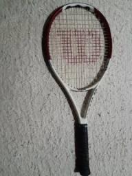 Raquete de tennis
