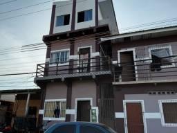 Prédio com 13 apartamentos e kit Net.