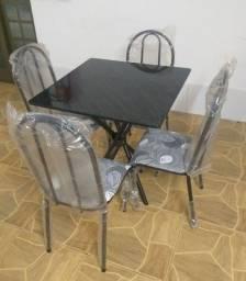Vendo mesa nova de pedra 4 cadeiras na caixa.