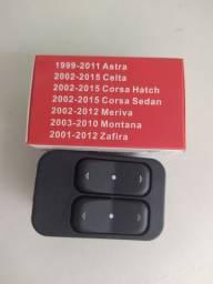 Botão duplo para vidro elétrico. Modelos dos carros na embalagem. Novo. R$ 80,00.