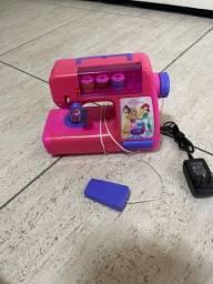 Máquina de costura infantil das princesas