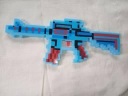 Brinquedo pistola a pilhas