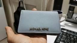 61ae4d373 Carteira feminina da marca Michael Kors V/T Dolce & Gabbana Off-White Gucci
