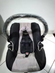 Bebê  conforto pra carro.