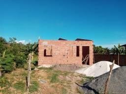 Vendo um terreno + casa em construção