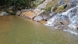 Terreno com maravilhosa cachoeira e natureza exuberante em Taquaraçu/MG