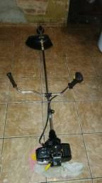 Vendo ou troco por uma bike aro 29 filé  máquina de cortar grama a gasolina
