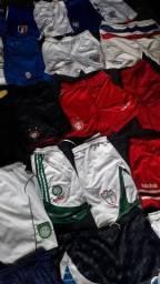 50 shorts e calcas variadas tam PMG