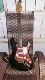 Guitarra com ou sem caixa