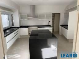Casa de condomínio para alugar com 4 dormitórios cod:650113