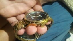 Vendo  relógio game x Dourado  aceito rolo
