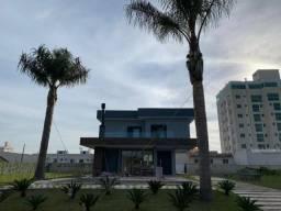 KB CA0052 linda casa 4 suítes 6 vagas em condomínio fechado em Camboriú