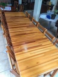 Mesa extensível 4 a 12 lugares com porta cadeiras