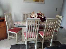 Vendo mesa de  vidro de sala estar 6 cadeira estofado vermelho  pé d mesa de mármore