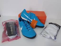 Chuteira Futsal Nike Original + Caneleira Puma + brinde