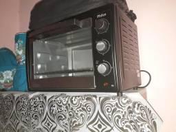 Vendo forno elétrico usado só 2 vezes no momento não tem utilidade para mim