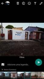 Vendo um terreno com 3 casas 10× 30 todo murado e dividido as casas !!