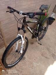 Vendo bicicleta aro 26 moss toda shimano cubo k7 suspensão de trava toda original