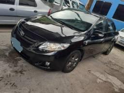 Corolla 2009 1.8 XL completo troco e financio manual e chave reserva - 2009