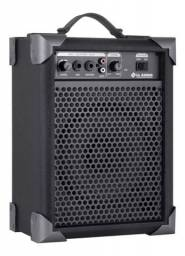 Caixa amplificada acompanha microfone sem fio barata