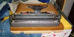 Máquina remington 25 e calculadora antiga olivetti
