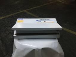 Máquina seladora manual