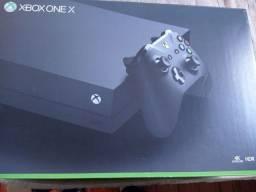 Xbox one x com caixa e assessórios um controle não acompanha jogos