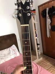 Instrumento Musical - Violão da cor preta, cordas de aço, elétrico, com afinador