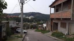 Venda 2 casas com terreno de esquina no bairro Jardim Carvalho.