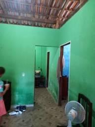 Uma casa com 2/4 2 salas cozinha banheiro área de serviço e em rol