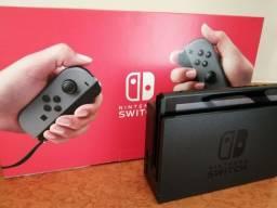 Nintendo Switch 32GB (V2) + SD Card 64GB + Zelda Breath of The Wild (mídia física)