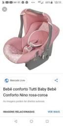 Alguém tem um bebê conforto de menina que não usa mais para doar estou precisando muito