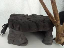 Pedra aquecida para répteis