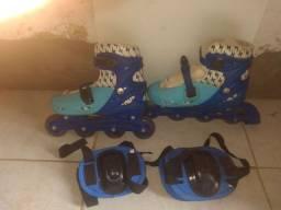 Vendo esse par de patins incluindo joelheiras e cotoveleiras