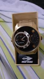 Relógio novo e um anel de formatura os dois por 900