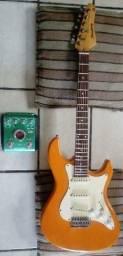 Guitarra e pedaleira zoom A2