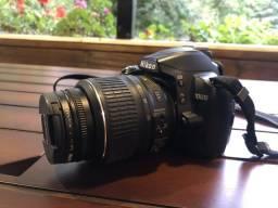 Nikon D3000 + lente 18-55mm