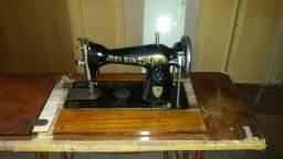 Máquina de costura antiga o q me oferecem