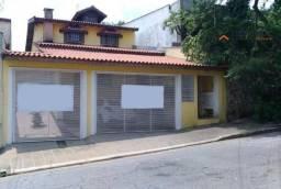 Sobrado com 4 dormitórios para alugar, 450 m² por R$ 6.000,00/mês - Vila Valparaíso - Sant