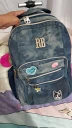 Vendo mochila de carrinho pra menina da Rebeca bonbon