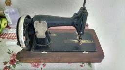 Maquina de costura antiga vesta