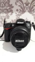 Máquina fotográfica Nikon D7000 + lente 18 - 55 mm
