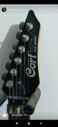 Guitarra Cort e pedal Wha hell babe
