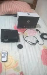 Vendo projetor wifi uc 46 com 1 mês de uso para vender logo
