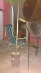 Cadeira e praia.