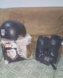 kit de proteção e um skate,ótimo estado