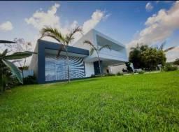Casa de condomínio para venda tem 480 metros quadrados com 4 quartos