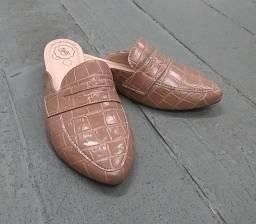Compre duas sapatilhas e ganhe mais uma