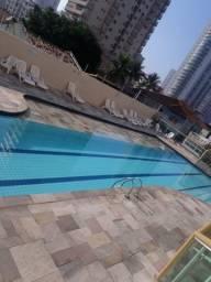 Apartamento na praia grande com vista para o mar, piscina, churrasqueira
