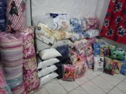 Travesseiros novos apartir de 20,00 reais